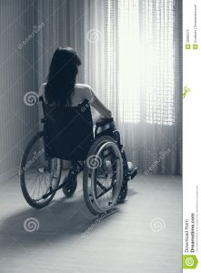 sad-woman-sitting-wheelchair-young-seated-looking-out-window-30985273